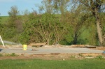 5/6/12 - their house, demolished, board by board, preparing for a new one.